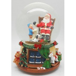 Snow globe Santa in the rocking chair