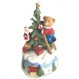 Music box bear decorating the Christmas tree