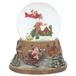 Snow globe flying Santa
