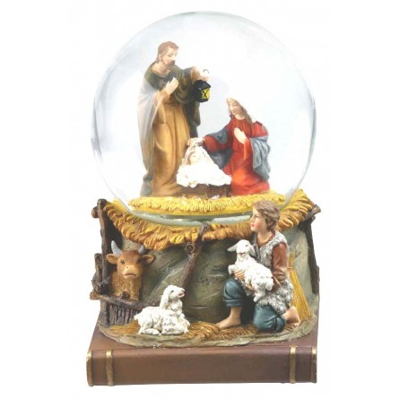 Snow globe nativity scene on book