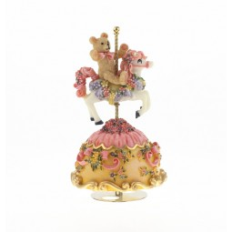 Teddy bear on carousel horse