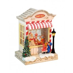 Santa's candy house with glitter globe