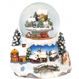 Snow globe mountain landscape with trains