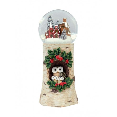 Snowglobe with a base looking like a tree trunk with an owl