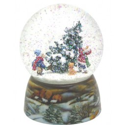 Snowglobe, porcelain base, children carry a Christmas tree