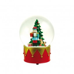 Snowglobe with a nutcracker and a christmastree