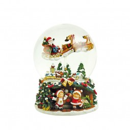 Snow globe music box with flying Santa and sleigh