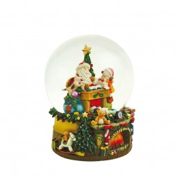 Snow globe music box with Santa, child and dog