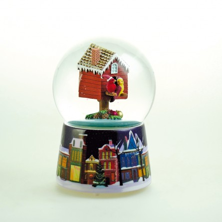 Snow globe music box with a pair of cardinals