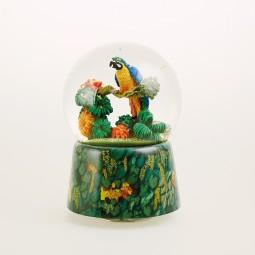 Glitter globe music box parrot