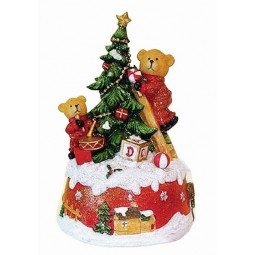 Bears decorating Christmas tree
