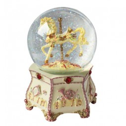 Glitter globe with a horse carousel