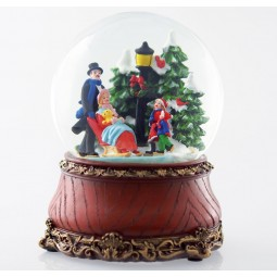 Snow globe with ice skaters