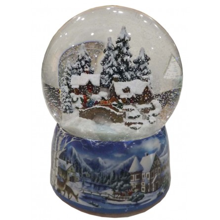 snow globe with a winter scene houses