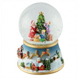 Snow globe with children decorating the tree