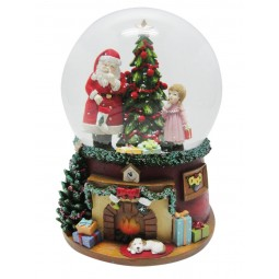 Santa snow globe with girl at the Christmas tree