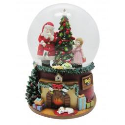 Santa snow globe with girl at the Christmas tree