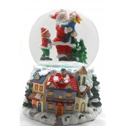 Snow globe Santa with children